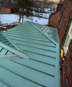 Snap - Lock Standing Seam Roof Panels made from Pac-Clad 24 Ga Flat Sheet Metal, smooth with Kynar Finish, color Aged Copper, seams 12'' O.C